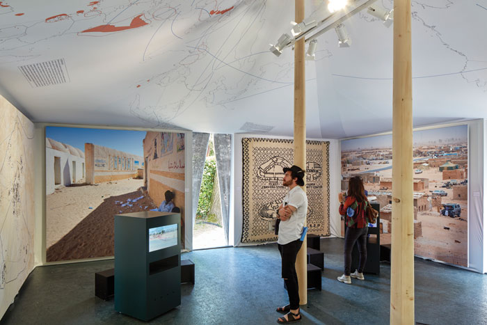 Occupying a deliberately ambiguous position, the Western Saharan pavilion stands in a no-man's land between Aravena's central pavilion and the national pavilions of the Giardini