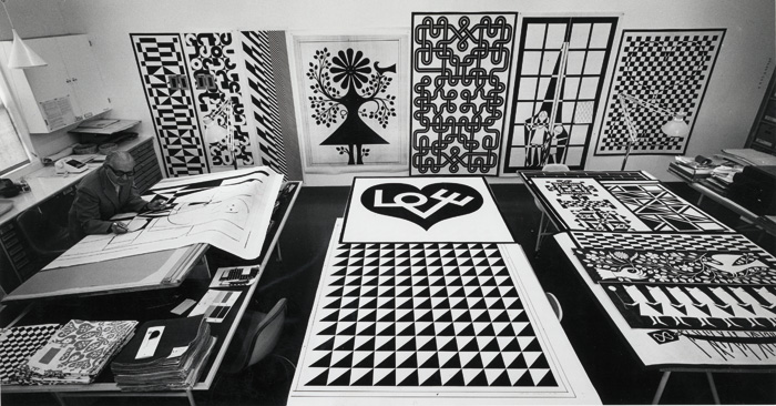 Alexander Girard photographed by Charles Eames designing the panels, about 1971. Photo: Charles Eames, Alexander Girard Estate, Vitra Design Museum