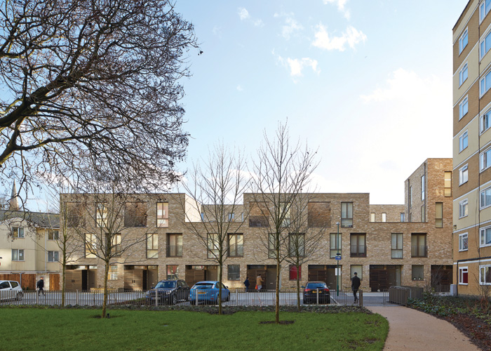 Terraced homes, flats and maisonettes frame new landscaped areas previously cut off from residents and the public