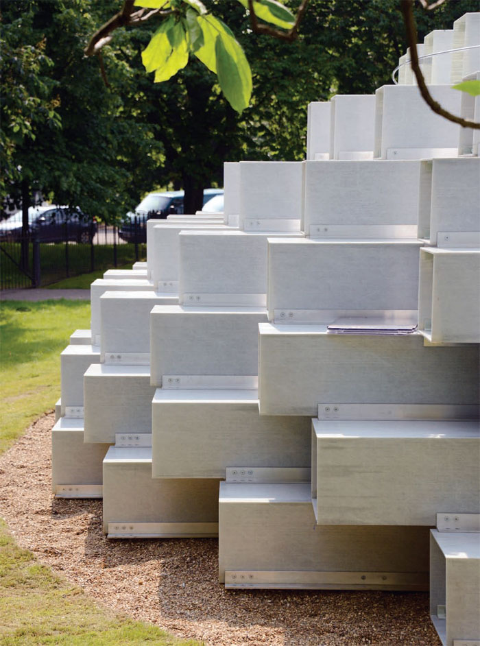The fibreglass bricks, held together with metal brackets, are a development of a shelving system BIG is designing