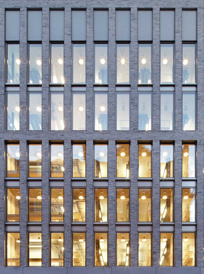 22 Gordon Street has been fully reclad in a skin of textured, waterstruck bricks