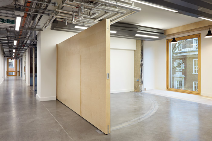 Breakout spaces can be divided off with moveable partitions for individual tutorials or group crits