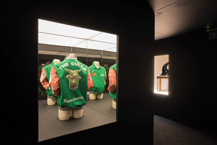 Branded baseball jackets represent a private joke about artists as 'bloody-know-alls'. Image Credit: Max Colson