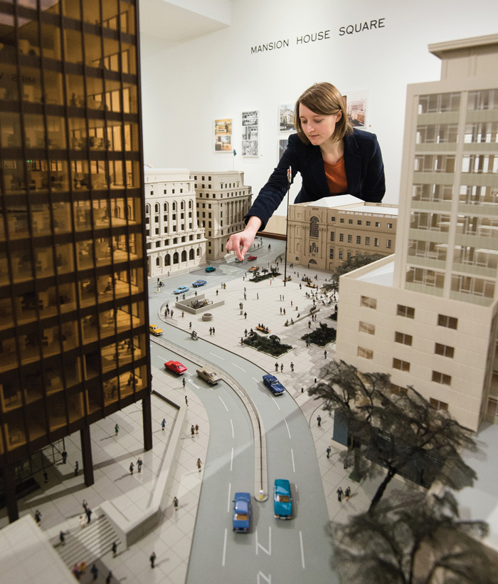 The great Mansion House Square model, showing (left to right) Mies' tower, the Midland Bank (Edwin Lutyens, 1939), 1 Princes Street (Edwin Cooper, 1932), a giant woman, Mansion House (George Dance, 1752) and Bucklersbury House (Owen Campbell- Jones, 1958, since demolished)