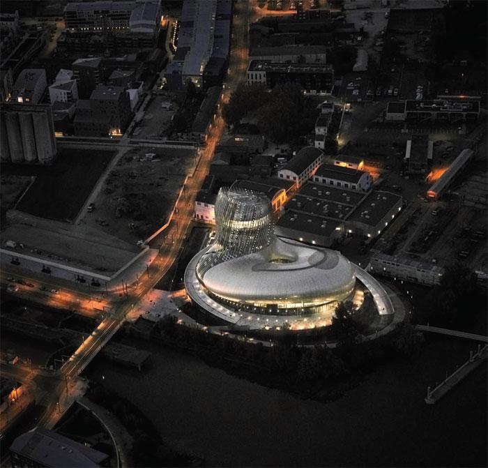 Cité du Vin at night, a shimmering new landmark for Bordeaux. Image Credit: XTU / P.Caumes