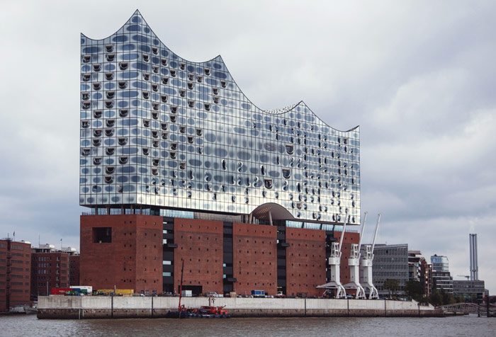 Then and now: Kaispeicher A in 1967, with ship docked, and in 2016, transformed into the Elbphilharmonie. Image Credit: Sophie Wolter