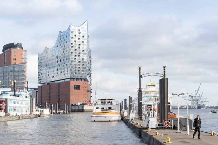 The Elbphilharmonie is shortest on its western end. On the north side, a four-storey arch marks a Plaza exit to the terrace