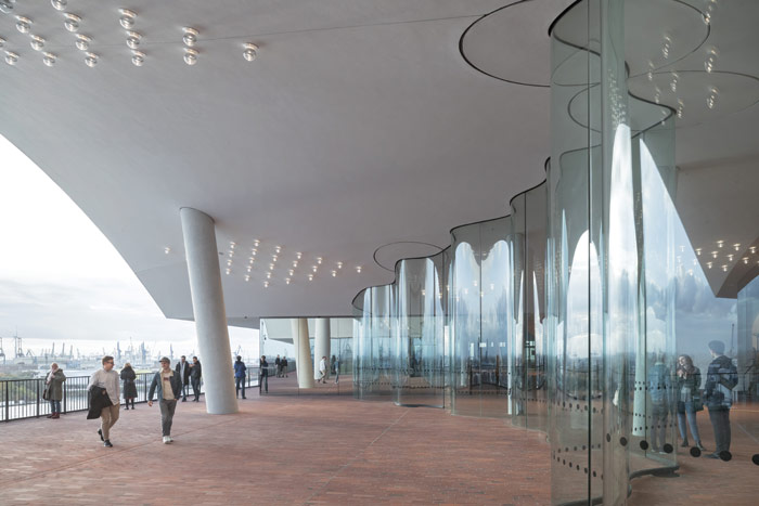 A curving glass wall separates the Plaza's internal area and the terrace. Image Credit: Iwan Baan