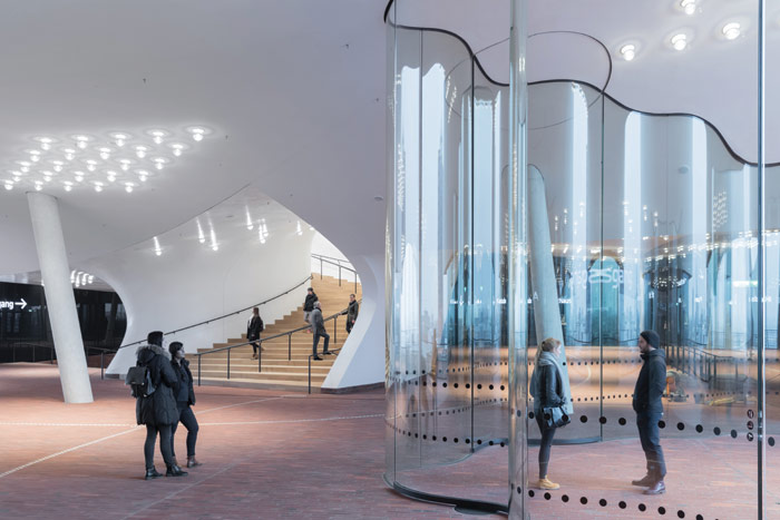 Inside the Plaza level, with an angled column supporting the Grand Concert Hall. Image Credit: Iwan Baan
