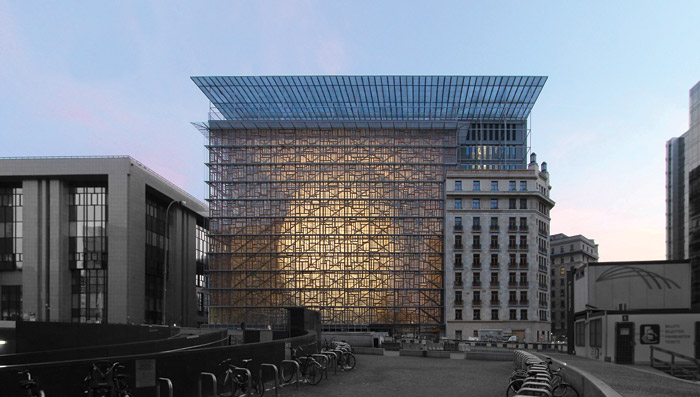 Seen from across the Rue de la Loi, the lantern shines through Europa's window frame facade, a Résidence Palace corner is to the right, all under the canopy. Image Credit: Quentin Olbrechts