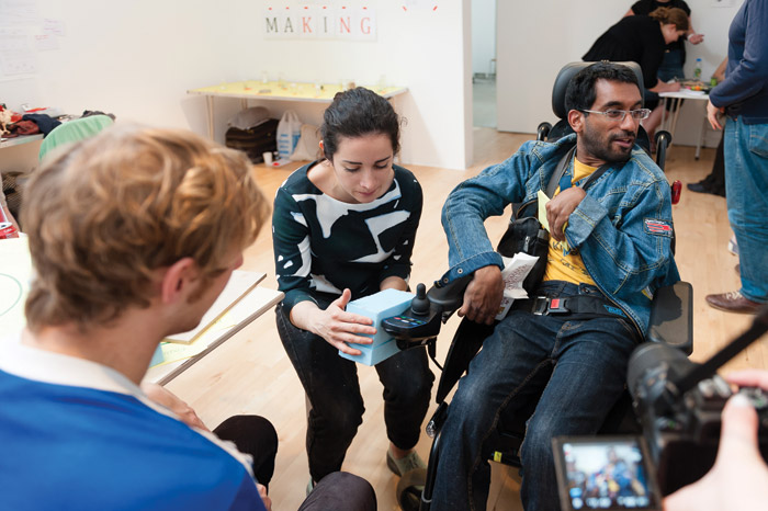 A broken joystick is repaired to power up an electric wheelchair, at Super Salon Day, at Stanley Picker Gallery in Kingston, 2013. Fixperts ran a drop-in repair event called Fixhub. Image Credit: Ezzidin Alwan