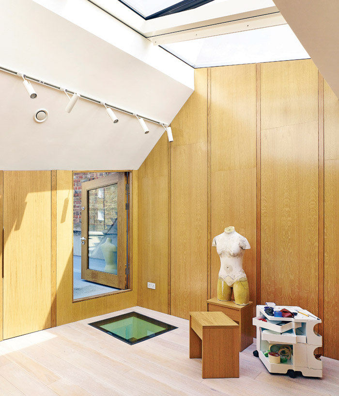The flexible, top-lit room is used by the owners as an artist studio and exhibition space