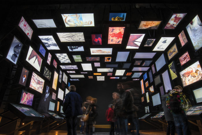An interactive digital gallery shows works by 20th-century artists influenced by the images found inside the Lascaux caves. Image Credit: Boegly + Grazia Photographers