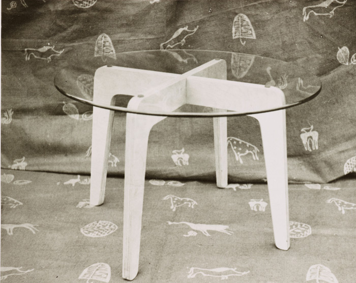 Bushmen blockprinted fabric (1940), with glasstopped table by Robin Day, in Lucienne Day's Royal College of Art Diploma Show. Image Credit: Robin & Lucienne Day Foundation