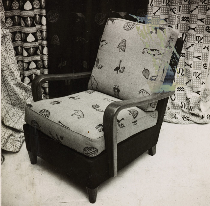 Bushmen blockprinted fabric (1940), used as upholstery on armchair designed by Robin Day, exhibited in Lucienne Day's Royal College of Art Diploma Show. Image Credit: Robin & Lucienne Day Foundation