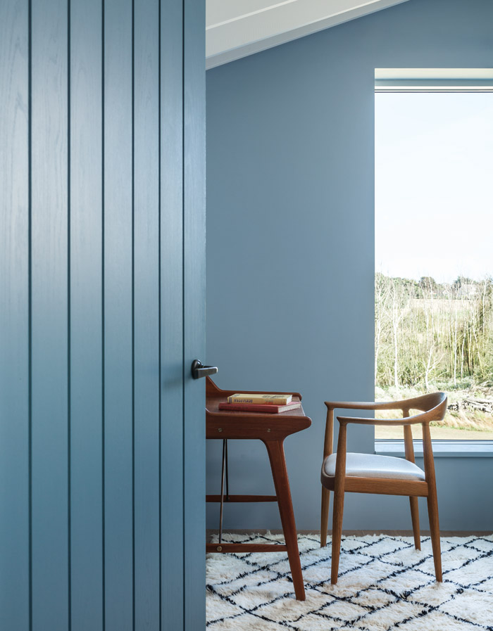 Deep blue walls and timber joinery give the study a tranquil feel