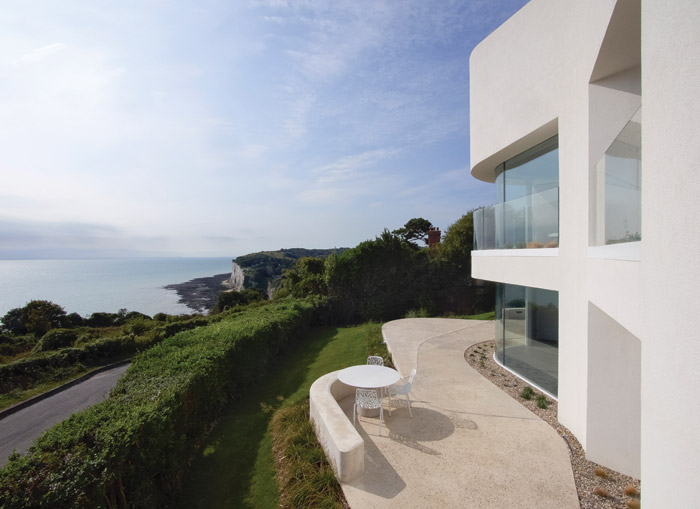 The recessed windows and shallow balconies provide panoramic views of the sea, and occasionally the French coast in the distance. Photo Credit: Nick Guttridge
