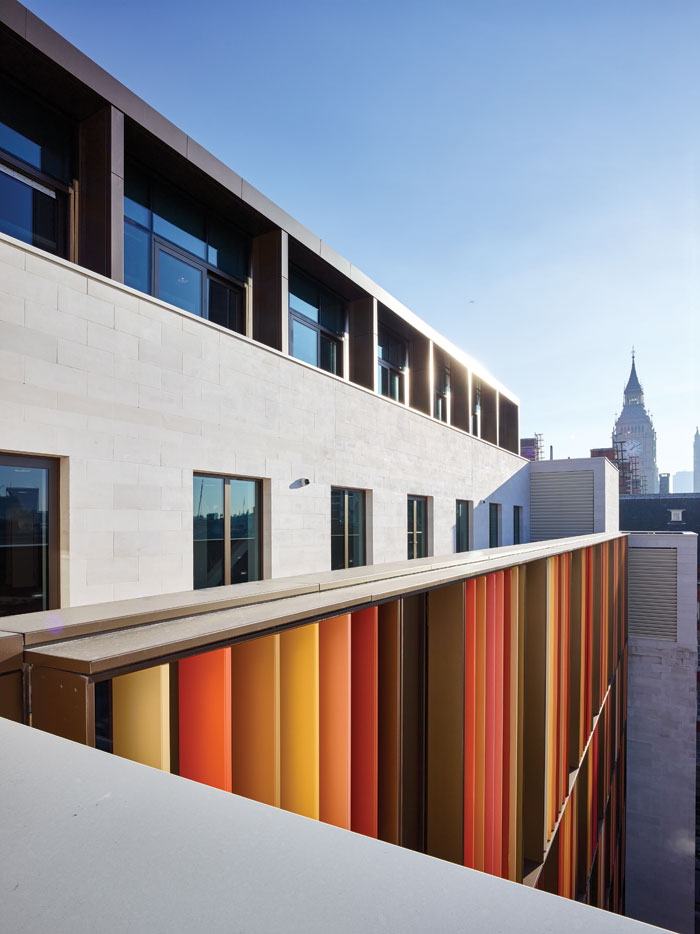 Multicoloured brise soleil on the roof terrace reference the colours of the cityscape