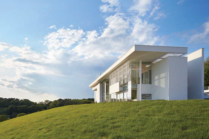 The house is a complex yet modernist composition, and features Meier's signature white louvers