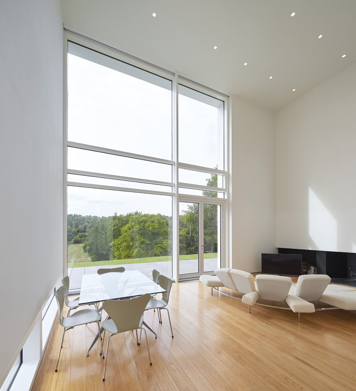 Large windows with thick mullions bring the landscape inside