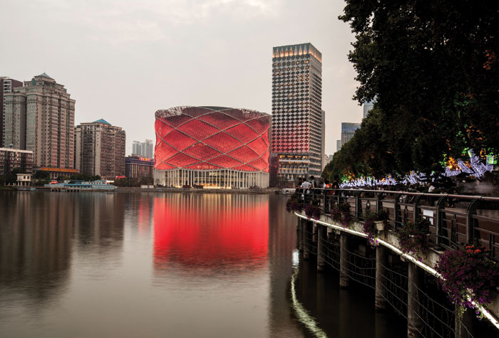 Looking across the lake to the Han Show Theatre, in Wuhan, China, designed by Stufish for the Dalian Wanda Group in 2014. Image Credit: Stufish
