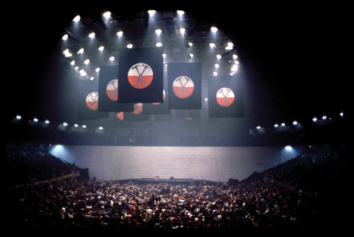 Shot from an original performance of The Wall in 1980. The Wall was designed by Mark Fisher, whose company Stufish has designed the V&A show. Image Credit: Stufish