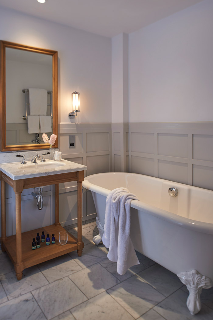 Bathrooms in the hotel's suites feature standalone roll-top baths and marble floors