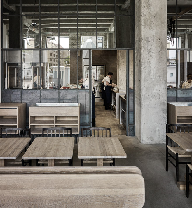 Restaurant 108 features exposed concrete elements and industrial details. Image Credit: Joachim Wichmann