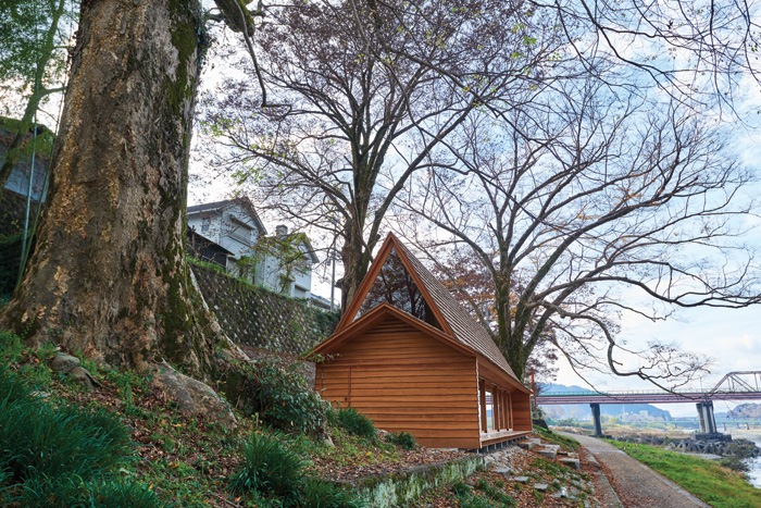 The house in its original position in the exhibition in Tokyo and below in its new and permanent home in Yoshino, alongside the river. Image Credit: Edward Caruso