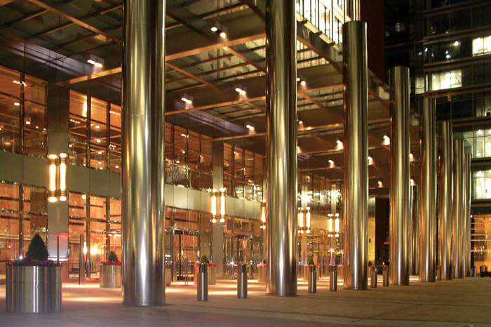 Stainless steel columns, colonnade and lighting at the base of One Canada Square - a post-modernist suggestion of art deco