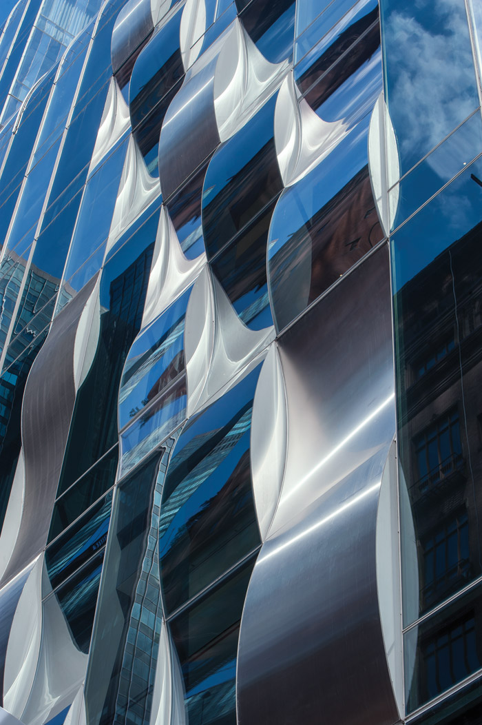 One57's frontage on 57th Street includes facade features emulating water waves. Photography - Wade Zimmerman