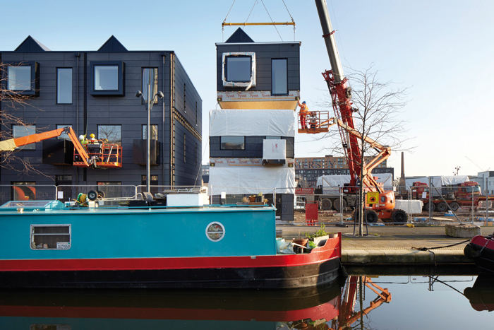 The wooden pods are stacked to create twoand three-storey homes