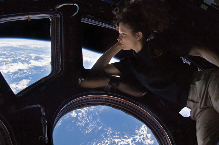 Astronaut Tracy Caldwell Dyson gazes through the Cupola in this 2010 self-portrait