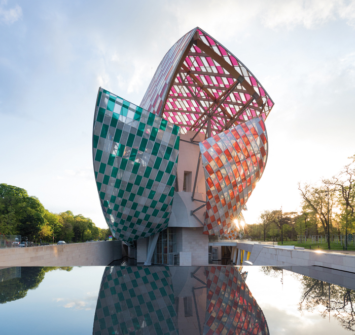 Each of Gehry's 12 sails is now covered in a pattern of coloured diamonds made of transparent film. Photo:Db-Adagp Paris / Iwan Baan / Fondation Louis Vuitton