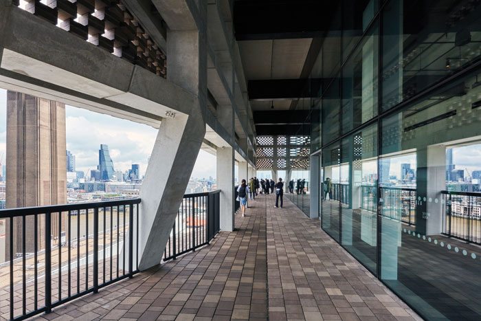 The Viewing Gallery is an all-round terrace paved with brick. This view includes Gilbert Scott's chimney and City skyscrapers