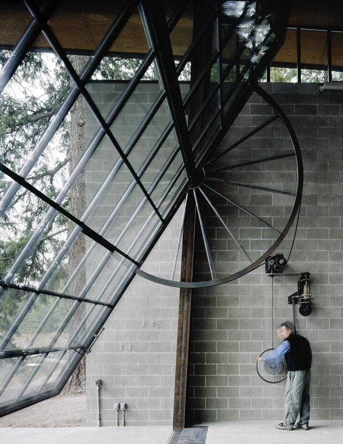 The Heath Robinsonesque door mechanism of Kundig's Chicken point cabin. Photo: Benjamin Benschneider