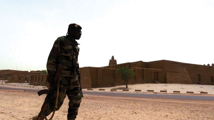 A Malian soldier outside a historical site