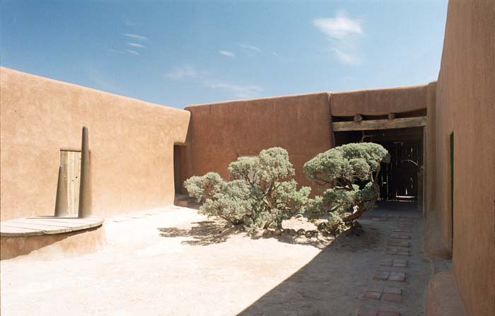 The patio at O'Keeffe's Abiquiu home. When she first viewed the ruin, the wall and door was a deal-clincher for her. 'It was something I had to have,' she wrote. Courtesy Georgia O'Keeffe Museum – Dacs London