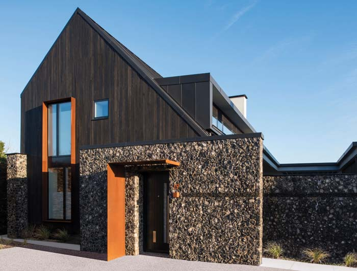 An Accent Of Corten Steel Is Introduced Around Windows And The Front Door,  Chosen To