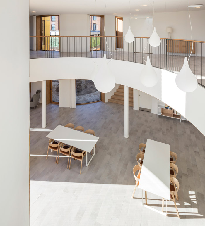 Architecture practice Nord has blended rectilinear and curved elements for rhythm and form for Urban Hospice in Copenhagen