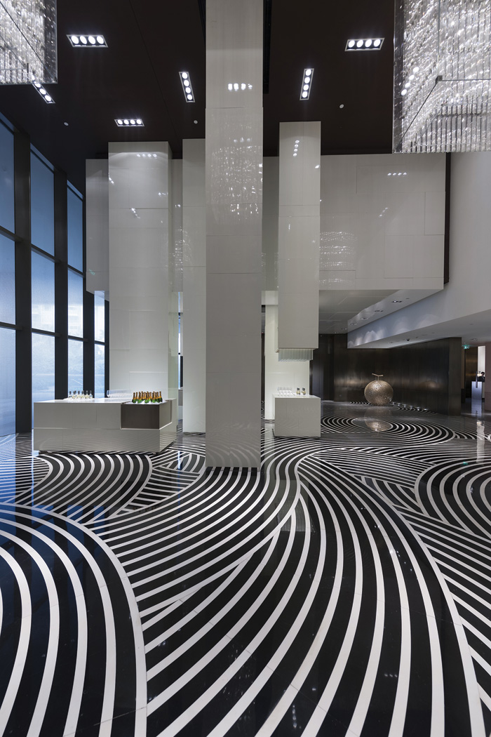 The flowing water of the Pearl River inspired Tony Chi & Associates' marble floor for the Mandarin Oriental, Ghangzhou