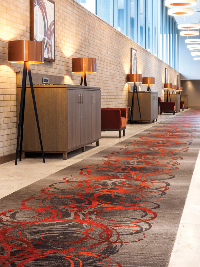 Ulster Carpets took inspiration from the company's circular logo to create a bespoke woven Axminster for Clayton Hotel, Chiswick