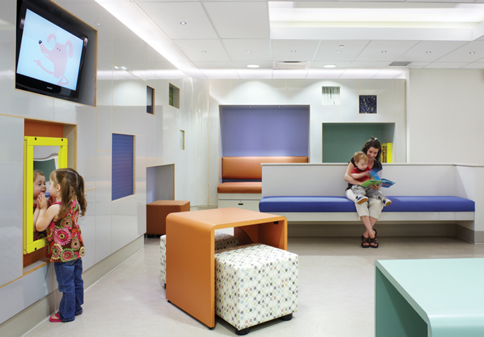Hospital for Sick Kids, Toronto – Emergency waiting area uses a neutral material and colour palette with accent colour to offer interest