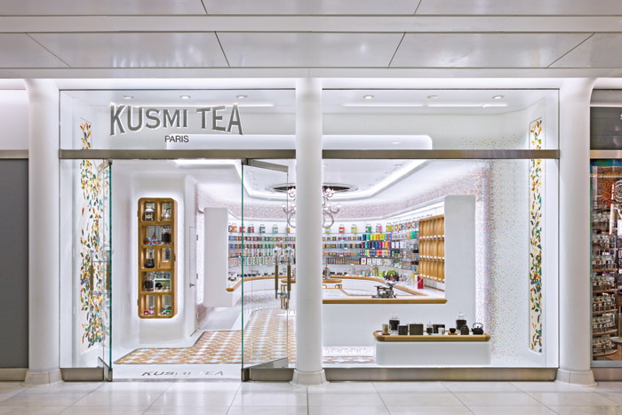 The bright and jewel-coloured interior of the luxury tea store is inviting