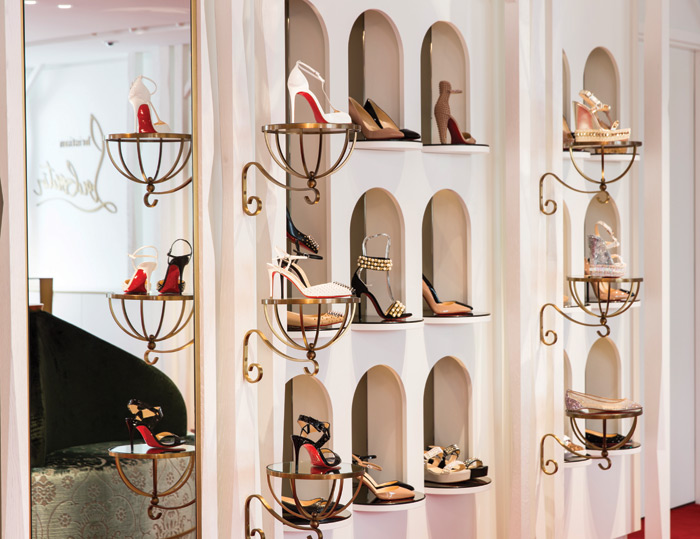 The way Louboutin's iconic women's shoes are displayed in niches and on plinths hint at the reverence in which they are held