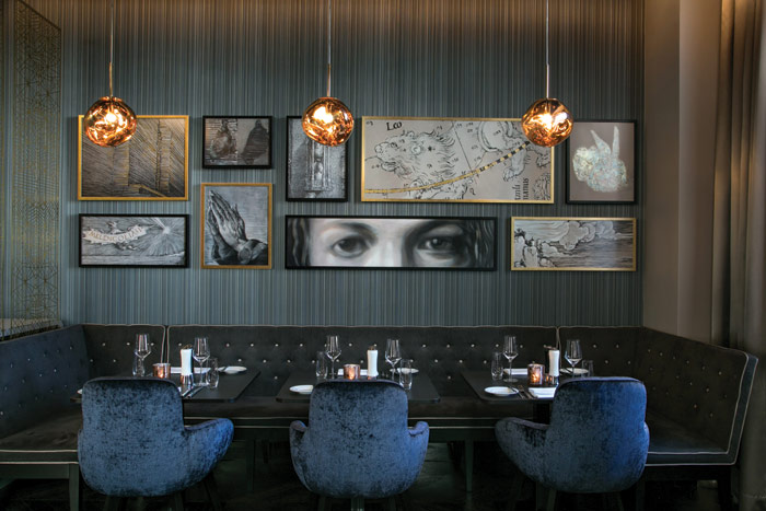 The hotel's restaurant has a wall decorated with art references to Durer, including his Young Hare and Hands, and detail from a self-portrait