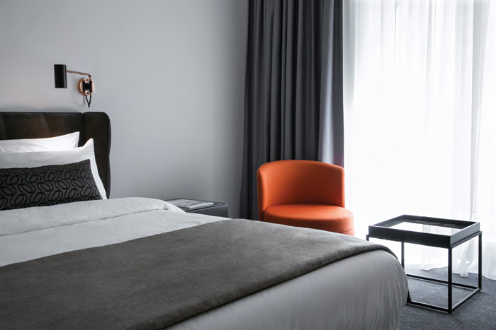 The hotel's 177 guest rooms feature a pared-down, contemporary aesthetic