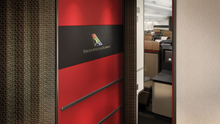 Subtle branding is added to the entrance to a business class cabin