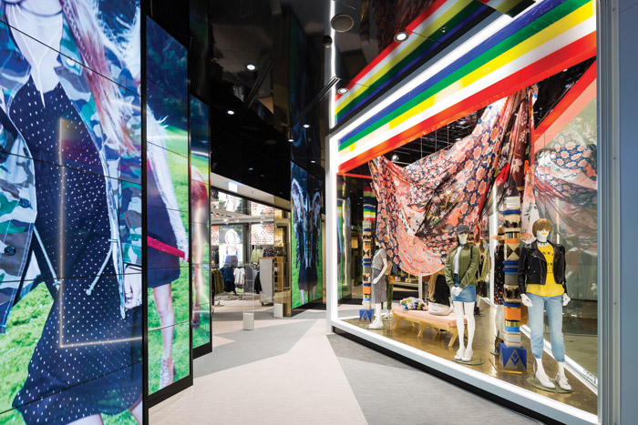 HMKM was tasked with designing a super-flagship store in Melbourne for Australian fashion brand Sportsgirl, with the aim of creating a new iconic architectural statement that reflected the interplay between the physical and the digital worlds. The shopfront is dominated by a striking triangular display window, guiding the customer into the store past high-impact floor-to-ceiling digital screens that showcase ever-changing brand content designed to appeal to digital natives