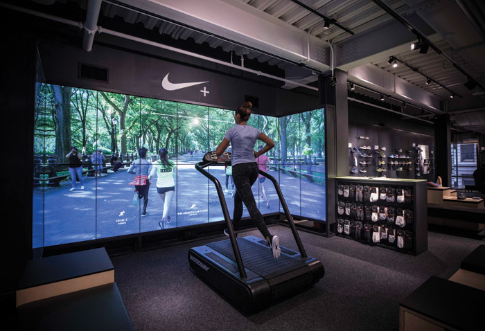 Nike's five-storey flagship store in New York features running zones, football areas and basketball courts so that customers can try before they buy